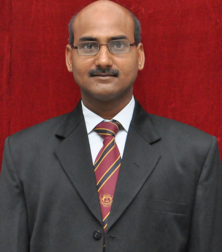 Dr Kamlendra Kumar